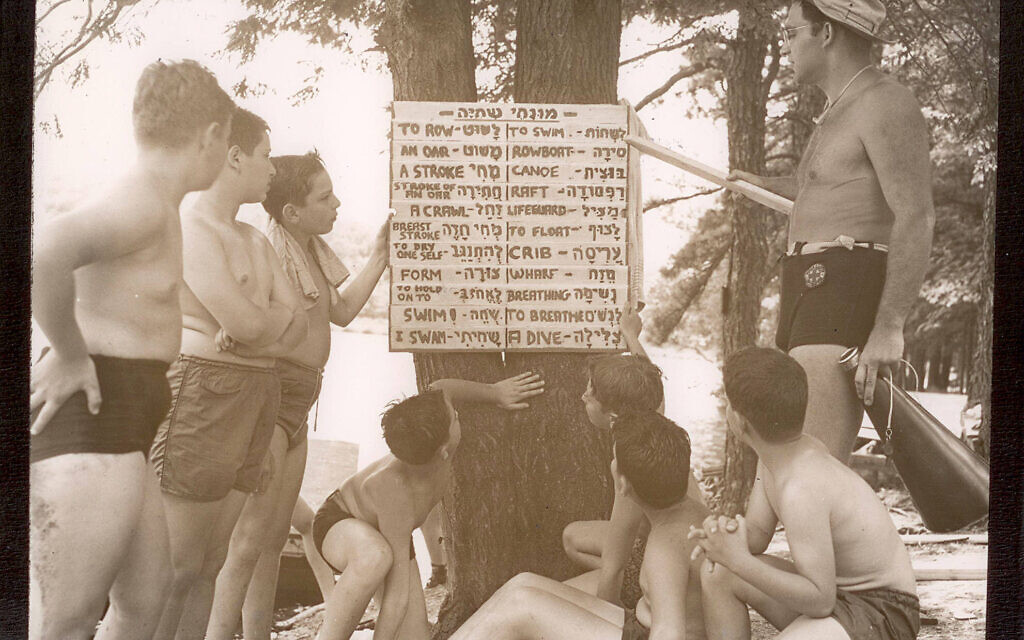Massad campers and staff consult a placard with Hebrew waterfront vocabulary. (Courtesy of Camp Massad Alumni Association and Elena Neuman Lefkowitz)