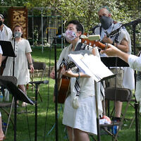 Illustrative: To create a pre-recorded online service, Rabbi Lizzi Heydemann, center, and musicians and singers from Mishkan Chicago recorded the songs and prayers of the High Holidays in August. (Courtesy of See3 Digital Events/ via JTA)