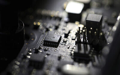 The inside of a computer in Jersey City, New Jersey, February 23, 2019. (AP Photo/Jenny Kane, File)