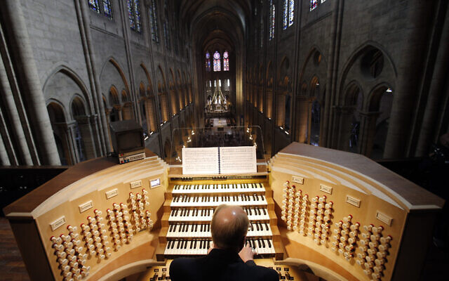 Philippe Lefebvre, 64, plays the organ at Notre Dame cathedral in Paris, May 2, 2013. (AP Photo/Christophe Ena, file)