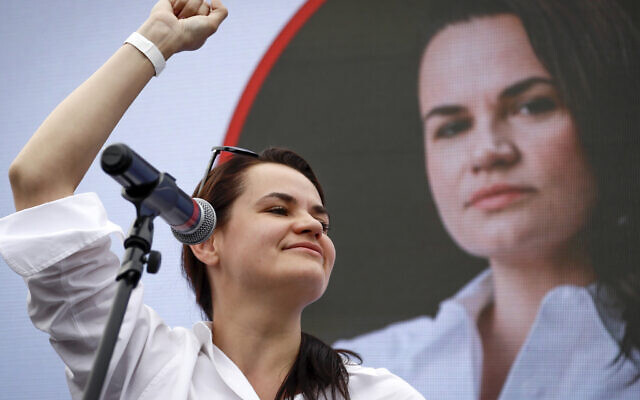 Sviatlana Tsikhanouskaya, candidate for the presidential elections, reacts during a meeting with her supporters in Minsk, Belarus, July 19, 2020. (AP Photo/Sergei Grits, File)