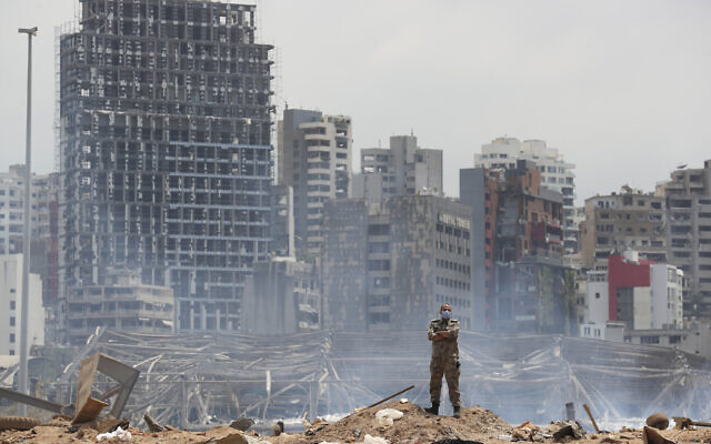 A soldier stands at the devastated site of the explosion in the port of Beirut, Lebanon, Thursday, Aug. 6, 2020 (AP Photo/Thibault Camus, Pool)