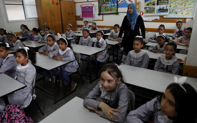 Students sit in a classroom on the first day of the new school year at the United Nations-run Elementary School at the Shati refugee camp in Gaza City, August 8, 2020. (AP Photo/Adel Hana)