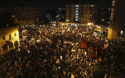 Thousands protest against Prime Minister Benjamin Netanyahu outside his official residence in Jerusalem on August 8, 2020.  (AP Photo/Ariel Schalit)