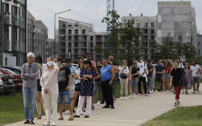 People queue to cast their votes in the Belarusian presidential election in Minsk, Belarus, Sunday, August 9, 2020. (AP Photo/Sergei Grits)