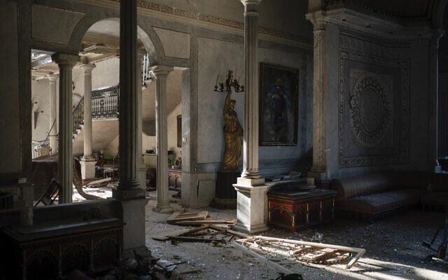 Broken glass and window frames lay on the floor of the Sursock Palace, heavily damaged after the explosion in the seaport of Beirut, Lebanon, Friday, August 7, 2020. (AP Photo/Felipe Dana)