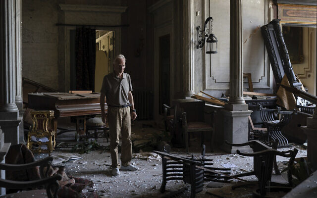 Roderick Sursock stands in a heavily damaged room of the Sursock Palace, affected by the explosion in the seaport of Beirut, Lebanon, August 8, 2020. (AP Photo/Felipe Dana)
