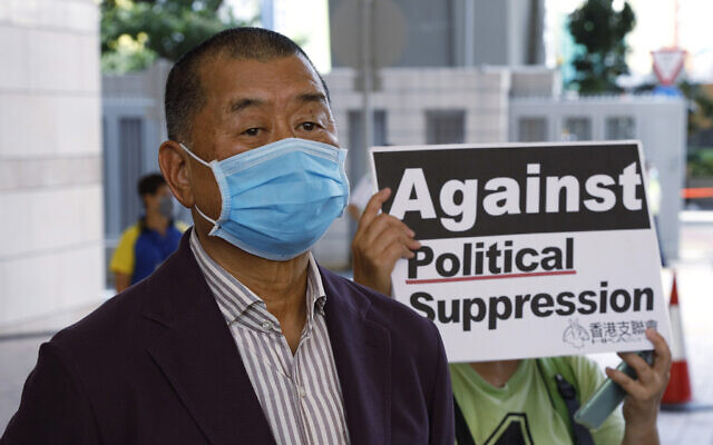 In this July 30, 2020, file photo, Hong Kong media tycoon Jimmy Lai, founder of the local newspaper Apple Daily, arrives a district court in Hong Kong. An aide to Hong Kong media tycoon Jimmy Lai says Lai was arrested Monday morning, Aug. 10, 2020, under the city's national security law on suspicion of collusion with foreign powers. (AP Photo/Kin Cheung, File)