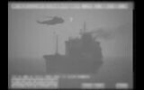 Iranian commandos fast-rope down from a helicopter onto the MV Wila oil tanker in the Gulf of Oman off the coast of the United Arab Emirates, August 12, 2020. (US military's Central Command via AP)