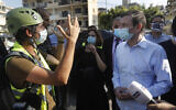 US Undersecretary of State for Political Affairs David Hale, right, listens to an NGO volunteer during his visit to a main gathering point for volunteers, near the site of the explosion that hit the seaport of Beirut, Lebanon, August 13, 2020. (AP Photo/Hussein Malla, Pool)