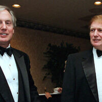 Robert Trump, left, joins then-real estate developer and future US president Donald Trump at an event in New York, November 3, 1999. (AP Photo/Diane Bonadreff, File)