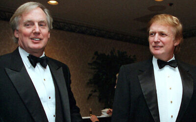 Robert Trump, left, joins then-real estate developer and future US president Donald Trump at an event in New York, November 3, 1999. (AP Photo/Diane Bonadreff, File)