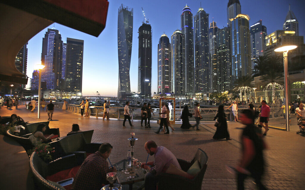 Two men play backgammon while smoking a shisha water pipe at a restaurant overlooking the canal and the Dubai Marina neighborhood in Dubai, United Arab Emirates, May 1, 2015. (AP Photo/Kamran Jebreili, File)