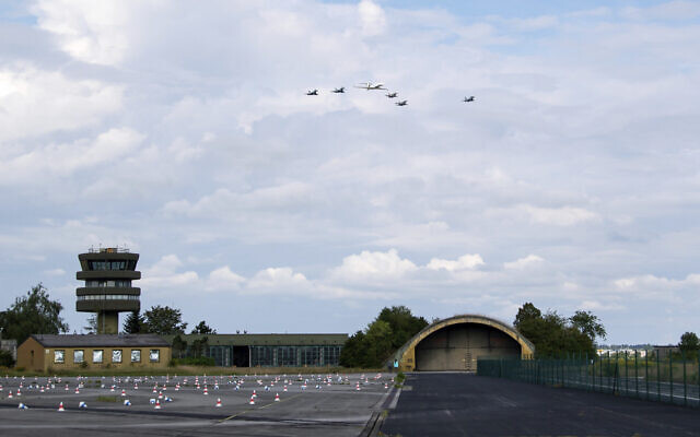 German air force Bundeswehr Eurofighters and an Israeli Air Force jets fly in formation over the Fuerstenfeldbruck airbase in commemoration of the 1972 Olympic Games assassination attempt in Fuerstenfeldbruck, Germany, Tuesday, Aug. 18, 2020. (Sven Hoppe/dpa via AP)