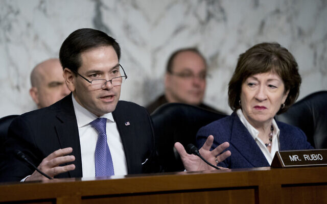 Sen. Marco Rubio, R-Fla., left, accompanied by Sen. Susan Collins, R-Maine, right, speaks before a Senate Intelligence Committee hearing on election security on Capitol Hill in Washington, March 21, 2018. (AP Photo/Andrew Harnik)