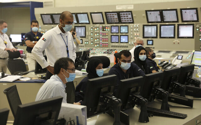 In this undated photograph published by the United Arab Emirates' state-run WAM news agency, employees work at the Barakah Nuclear Power Plant in the UAE's far western desert. (WAM via AP)