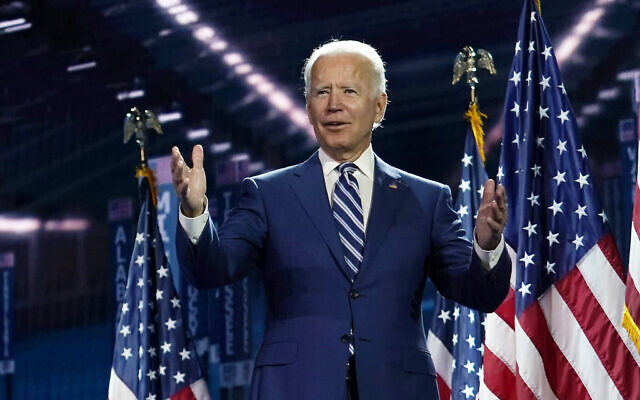 Democratic presidential candidate Joe Biden stands on stage after Democratic vice presidential candidate Sen. Kamala Harris, D-Calif., spoke during the third day of the Democratic National Convention, Wednesday, Aug. 19, 2020, at the Chase Center in Wilmington, Del. (AP Photo/Carolyn Kaster)