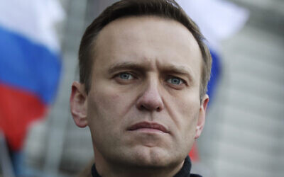 In this file photo taken on Saturday, Feb. 29, 2020, Russian opposition activist Alexei Navalny takes part in a march in memory of opposition leader Boris Nemtsov in Moscow, Russia (AP Photo/Pavel Golovkin)