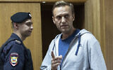 Russian opposition leader Alexei Navalny gestures while speaking in a court room in Moscow, Russia, August 27, 2018. (AP Photo/Pavel Golovkin, File)