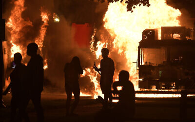 Garbage and dump trucks set ablaze by rioters near the Kenosha County Courthouse in Kenosha, Wisoncin, August 23, 2020. (Sean Krajacic/Kenosha News via AP)