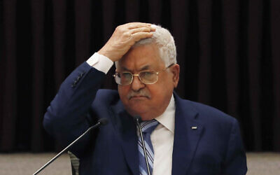 Palestinian Authority President Mahmoud Abbas gestures during a meeting to discuss the United Arab Emirates' deal with Israel to normalize relations, in the West Bank city of Ramallah, August 18, 2020. (Mohamad Torokman/Pool Photo via AP, File)