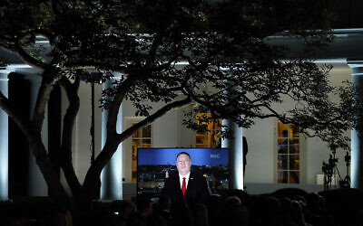 A video of Secretary of State Mike Pompeo speaking during the Republican National Convention plays from the Rose Garden of the White House, on August 25, 2020. (AP/Evan Vucci)