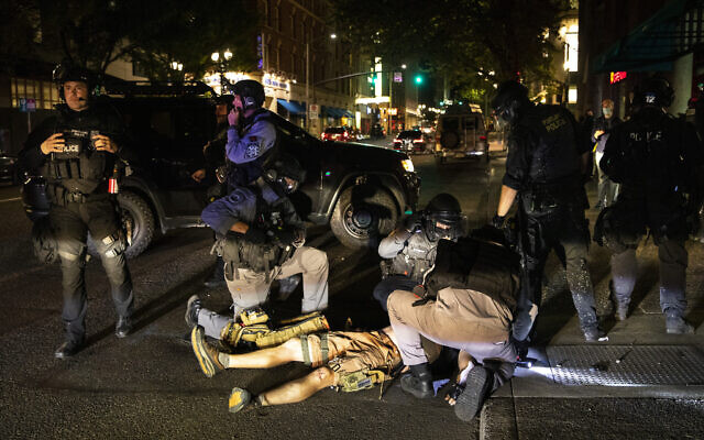 A man being treated after being shot  in Portland, Oregon, August 29, 2020. (Paula Bronstein/AP)