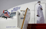 An official stands at the door of an Israeli El Al airliner after it landed in Abu Dhabi, United Arab Emirates, August 31, 2020. (Nir Elias/Pool Photo via AP)