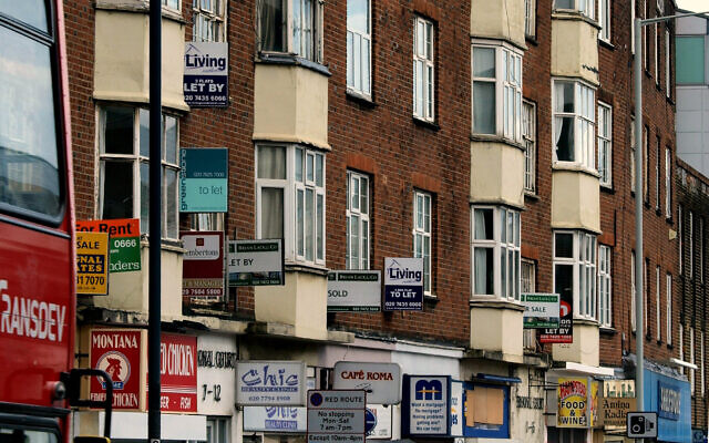 Illustrative: Billboards advertising property for rent and for sale are seen on London's Finchley Road, Wednesday, April 30, 2008. (AP Photo/Max Nash)