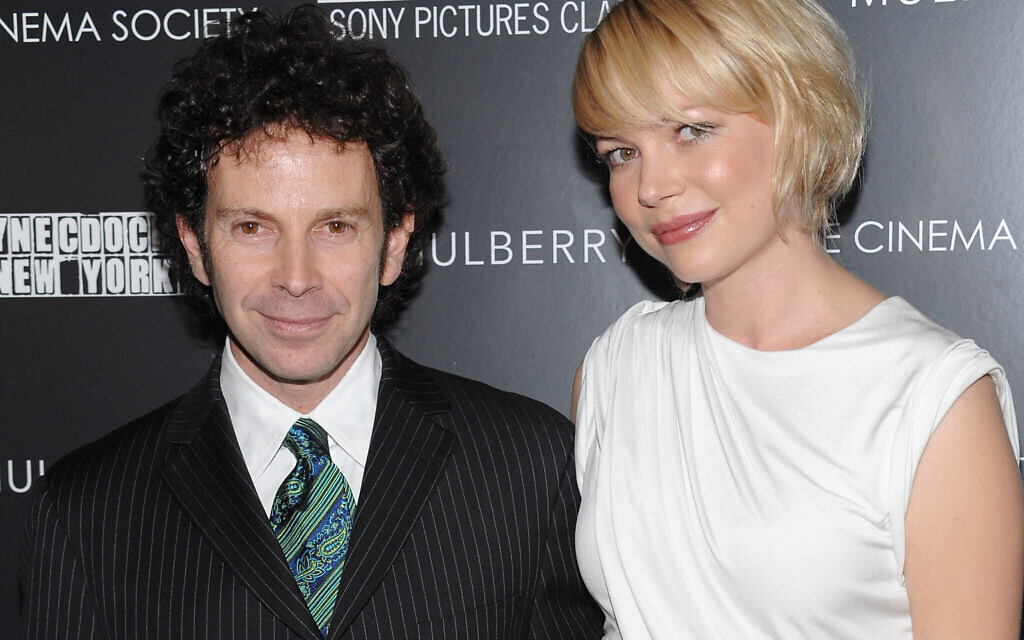 Writer-director Charlie Kaufman, left, and actress Michelle Williams attend a Cinema Society hosted screening of 'Synecdoche New York' on Wednesday, October 15, 2008 in New York. (AP Photo/Evan Agostini)