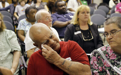 Charles Holt wipe tears from his eyes during a Justice for Sterilization Victims Foundation task force compensation hearing in Raleigh, North Carolina, June 22, 2011 (AP Photo/Jim R. Bounds)