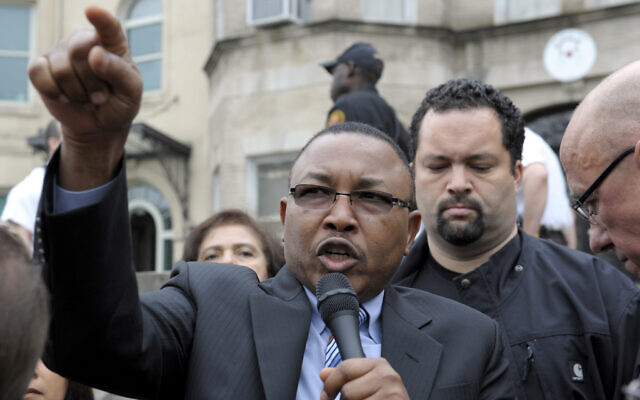 Omer Ismail, formerly of the Enough Project and currently the acting foreign minister of Sudan, speaks during a protest at the Sudan Embassy in Washington, Friday, March 16, 2012. (AP Photo/Cliff Owen)