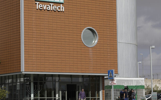 A man walks out of Teva Pharmaceutical facility building in Neot Hovav, Israel, Thursday, Dec. 14, 2017. (AP Photo/Tsafrir Abayov)