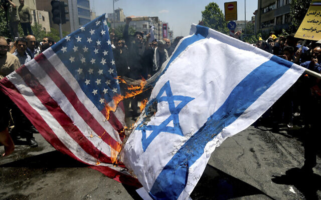 Iranian protesters burn Israeli and US flags on June 8, 2018. (AP/Ebrahim Noroozi)