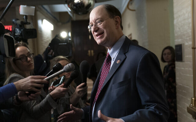 Rep. Brad Sherman, D-Calif., talks to reporters in a basement corridor at the Capitol after he introduced articles of impeachment against President Donald Trump on Thursday, the first day of the new Congress with Democrats in the majority, in Washington, Friday, Jan. 4, 2019. (AP Photo/J. Scott Applewhite)