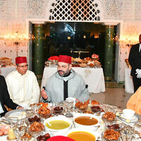 Moroccan King Mohammed VI (center) chats with Jared Kushner, senior adviser to US President Donald Trump (left) as crown Prince Moulay Hassan (right) looks on before an Iftar meal, the evening meal when Muslims end their daily Ramadan fast at sunset, at the King Royal residence in Sale, Morocco, May 28, 2019. (Moroccan Royal Palace, via AP)