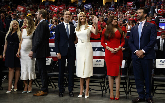 From left, Tiffany Trump, Lara Trump and Eric Trump, senior adviser Jared Kushner and Ivanka Trump, and Kimberly Guilfoyle and Donald Trump Jr., watch as US President Donald Trump speaks at his re-election kickoff rally at the Amway Center, June 18, 2019, in Orlando, Florida. (AP Photo/Evan Vucci)