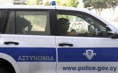 Illustrative: Police officers in Paralimni, Cyprus, Monday, Aug. 19, 2019 (AP/Philippos Christou)