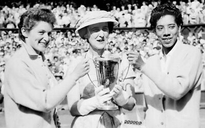 The Duchess of Kent, center, presents the trophy for the Ladies' Doubles title to Angela Buxton, left, and Althea Gibson, right, following their victory at Wimbledon, England. (AP Photo/File)