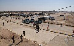 Illustrative: Iraqi security forces prepare to open the crossing between the Iraqi town of Qaim and Syria's Boukamal, in Qaim, Iraq, Monday, Sept. 30, 2019. (AP Photo/Hadi Mizban)