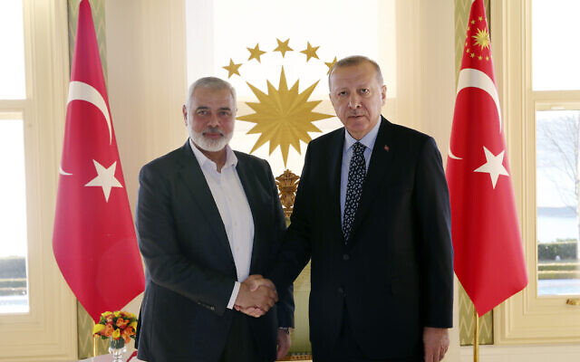 Turkey's President Recep Tayyip Erdogan, right, shakes hands with Hamas terrorist movement chief Ismail Haniyeh, prior to their meeting in Istanbul, February 1, 2020. (Presidential Press Service via AP, Pool)