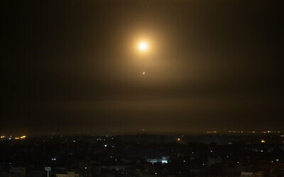 Illustrative: An explosion caused by Iron Dome air defense system missiles intercepting rockets fired from Gaza, February 23, 2020. (AP Photo/Khalil Hamra/ File)
