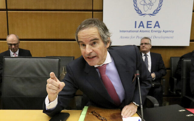 Director General of the International Atomic Energy Agency, IAEA, Rafael Mariano Grossi  talks prior to the start of the IAEA board of governors meeting at the International Center in Vienna, Austria, Monday, March 9, 2020. (AP Photo/Ronald Zak)