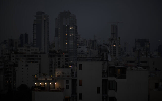Illustrative: The capital city of Beirut remains in darkness during a power outage, on July 6, 2020. (AP Photo/Hassan Ammar)