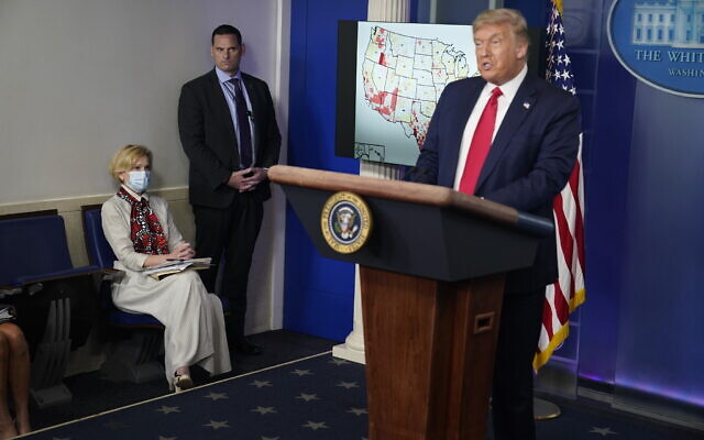 White House coronavirus response coordinator Dr. Deborah Birx, left, listens as US President Donald Trump speaks during a news conference at the White House, July 23, 2020, in Washington. (Evan Vucci/AP)