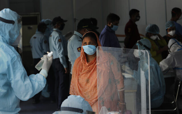 Indian health volunteers register people participating in the India-Israel Non-Invasive Raid COVID-19 test study camp, at a government hospital in New Delhi, India, Friday, July 31, 2020. (AP/Manish Swarup)