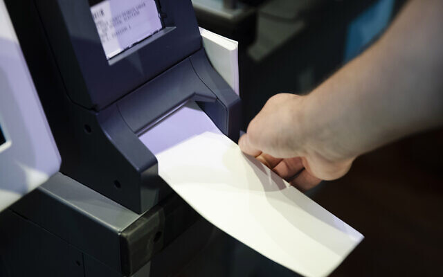 In this June 13, 2019 file photo, an Investigator with the Office of the City Commissioners, demonstrates the ExpressVote XL voting machine at the Reading Terminal Market in Philadelphia (AP Photo/Matt Rourke, File)