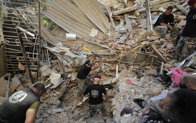 Lebanese soldiers search for survivors after a massive explosion in Beirut, Lebanon, August 5, 2020. (Hassan Ammar/AP)
