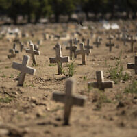 Crosses fill the Caju cemetery, where some victims of the new coronavirus pandemic have been buried, in Rio de Janeiro, Brazil, Friday, Aug. 7, 2020. (AP/Silvia Izquierdo)
