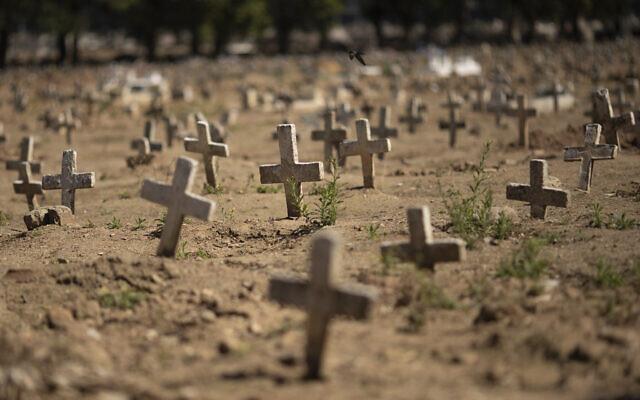 Crosses fill the Caju cemetery, where some victims of the new coronavirus pandemic have been buried, in Rio de Janeiro, Brazil, Friday, Aug. 7, 2020. (AP/Silvia Izquierdo)